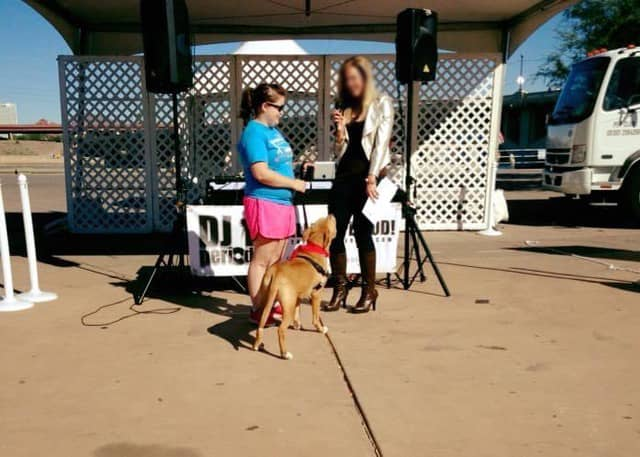 Laura Martinez with a dog talking to a reporter
